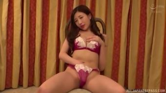 Solo Japanese MILF model Aise Kurara puts her hand down her panties