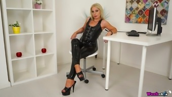 Sexy mistress in latex Jamie T is playing with her smooth pussy