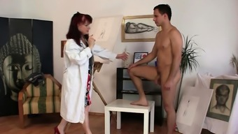 Very beautiful redhead mature woman rides his cock