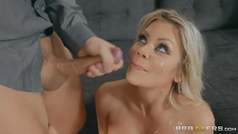 Blonde in lingerie Riley Steele opens her eyes and mouth wide for cum