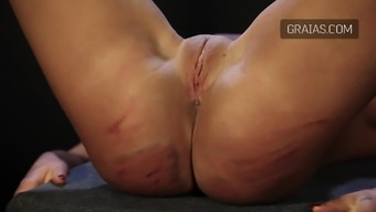 A most brutal whipping of a beautiful shaved pussy