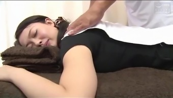 Dark haired Japanese babe massaged and pussy fucked afterwards