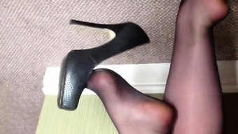 Louise Nylon dangling her high heels before afternoon fun