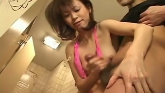 Hot handjob and a blowjob from a kinky Japanese doll
