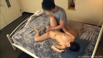 Amateur brunette Japanese MILF missionary fucked in a skirt