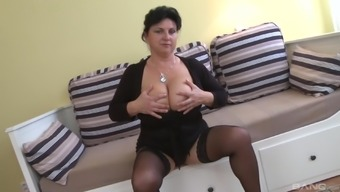 Big tit mature adores to show her naked body while she blows more than one cock