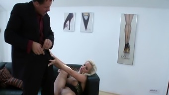 Blonde MILF sucks dick