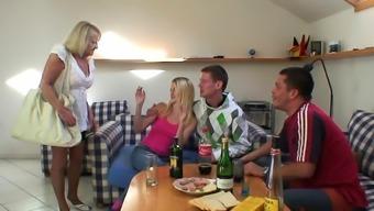 Her old blonde mother enjoys two big cocks