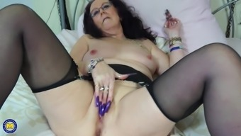Mature brunette granny Zadi strokes her pussy with her long nails