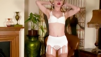 Blonde Chloe Toy strips off pretty white lace panties and wanks in delicate sheer nylons
