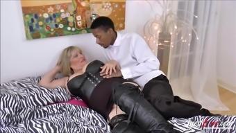 Busty blonde mature gets big black cock deep inside her vagina