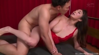 clothed sex is what horny mature Otowa Ayako prefers with this dude