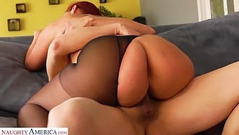 Bright red haired woman Kelly Divine gets her pussy fucked in ripped pantyhose