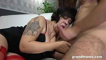 Sassy granny in red stockings getting fucked in a hot MMF threesome