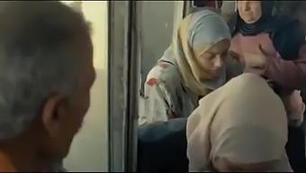 Arab woman in hijab in the bus