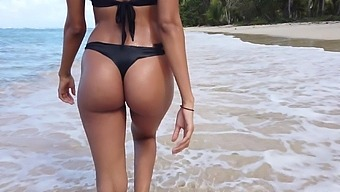 Graceful babe flashing her ass and tits in the most paradisiacal location