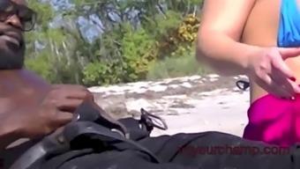 two married women teasing men on the beach