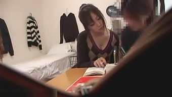 Japanese private teacher helps student in his room